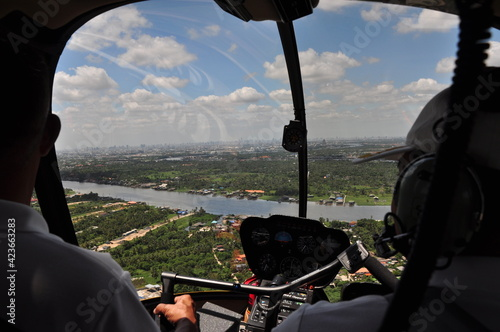 Fotografie, Obraz Helicopter flying sightseeing around Thailand