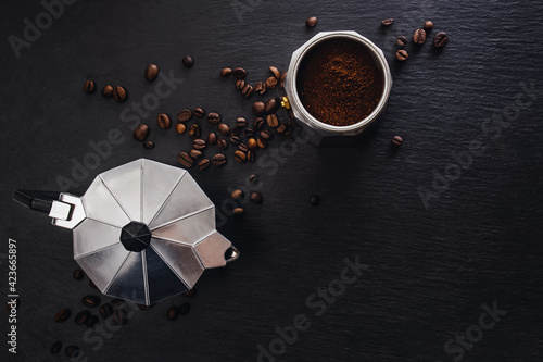 Still life with moka pot and coffee beans on black stone background Poster Mural XXL