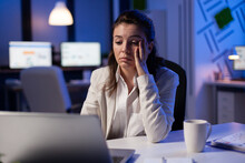 Tired Woman Fall Asleep Checking Financial Analyze Late At Night In Start-up Business Office. Exhausted Manager Planning New Project With Teamates Using Modern Technology Network