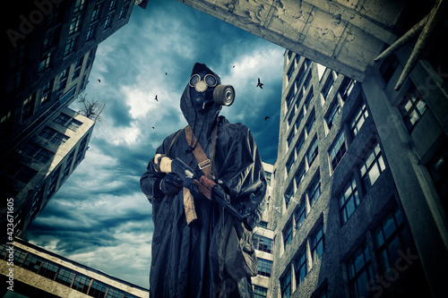Billede på lærred Cyber punk, postapocalyptic world, man in goggles, gas mask inside of rusty buil