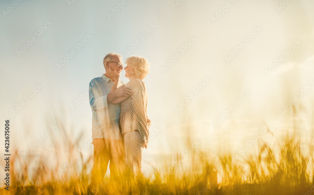 Fototapeta Senior couple embracing each other in love outdoors