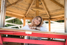 Female Model Posing In Wooden Gazebo Near Lake Ar Sity Park