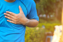 An Asian Man Having An Ache In His Chest Or Heart Attack While Running.