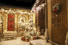 Realistic Decorated Studio Christmas Street With Two Adjacent Houses With Icicles, Porch, Doors With Wreaths, Christmas Trees, Snowman, A Sleigh And Fake Sno