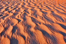 Harmonious Lines Of Sand In The Desert At Sunrise; Bizarre Wind Patterns In The Soft Light Of The Rising Sun