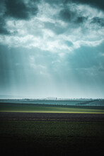Dramatic Spring Nature With Dramatic Clouds And Light Rays And Green Countryside Nature