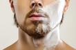 Leinwandbild Motiv Man with a shaving cream on his face