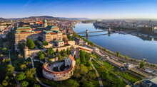 Budapest, Hungary - Aerial Panoramic Skyline View Of Buda Castle Royal Palace With Szechenyi Chain Bridge, St.Stephen's Basilica, Parliament Of Hungary And Matthias Church On A Summer Morning