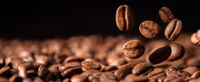Coffee Beans Falling Into A Heap Background