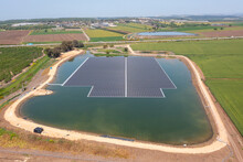 Floating Solar Panels In A Large Water Reservoir, Aerial View.