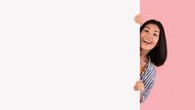 Asian Woman Hiding Behind Blank White Advertising Billboard