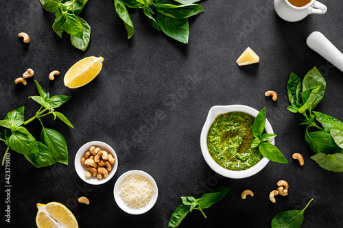 Fotografie, Obraz Pesto basil with ingredient for cooking on black background, top view