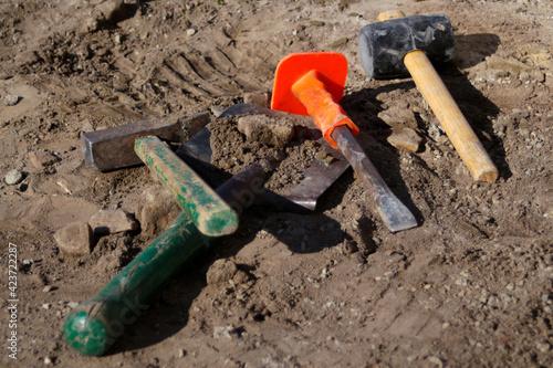 Slika na platnu Defocus hammer, mallet, chisel and bayonet of the shovel lie on the ground