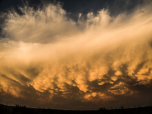 Imposing Clouds Of A Coming Storm With Orange Tones