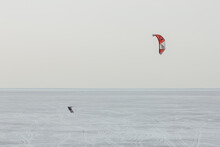 Snow Kiter Gliding On The Sea Surface In The Late Spring.