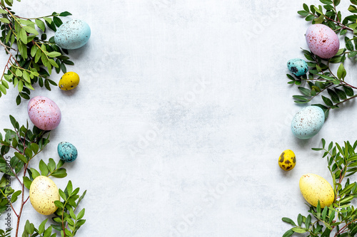 Fototapeta Frame of Easter eggs with spring branches and green leaves. Veiw from above obraz