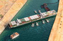 Ever Given Has Been Freed In Suez Canal. Effort To Refloat Vast Wedged Container Cargo Ship By Tug Boats, Dredger Ship 3D Illustration. Giant Cargo Ship Dislodged And Refloated In Egyptian Suez Canal