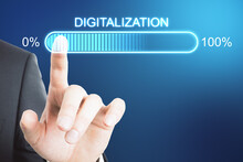 Digital Transformation Concept With Businessman Hand On Virtual Interface With Digitalization Word And Loading Bar Element.