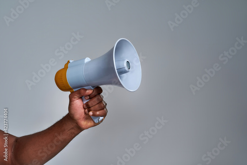 Obraz na plátne Megaphone held by african american person