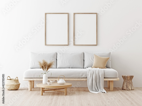 Two wooden vertical frames mockup in living room interior with gray sofa, beige pillow, dried Pampas grass on caned table and Japandi style decor on empty wall background. 3D rendering, illustration