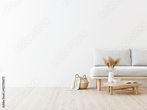 Fototapeta Living room interior wall mockup in warm neutrals with low sofa, dried Pampas grass on caned table and japandi style decoration on empty white wall background. 3D rendering, illustration. obraz