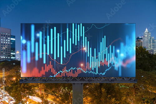 FOREX graph hologram on billboard, aerial night panoramic cityscape of Bangkok. The developed location for stock market researchers in Southeast Asia. The concept of fundamental analysis