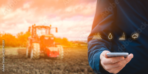 Intelligent agriculture concept with tractor in background