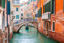 Beautiful Canal With Old Medieval Architecture And Bridge In Venice, Italy. Famous Travel Destination