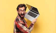 Young Crazy Bearded Man Angry Expression And A Laptop