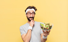 Young Crazy Bearded Athlete Thinking Expression And Holding A Salad