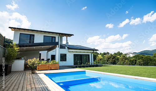 Obraz House with swimming pool outdoors in backyard garden. - fototapety do salonu