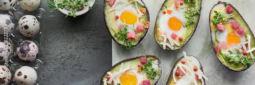 Obraz na plátně Keto diet dish: Avocado boats with ham cubes, quail eggs, cheese