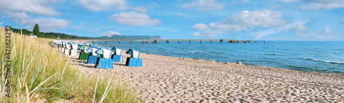 Sandy beach and traditional wooden beach chairs on island Rugen