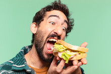 Young Crazy Bearded Man Happy Expression And Holding A Sandwich