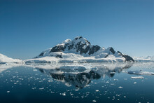 Lemaire Strait Coast, Mountains And Icebergs, Antartica