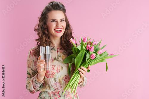 Tela smiling modern female in floral dress on pink