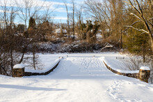 Snow Covered Foot Bridge After A Blizzard