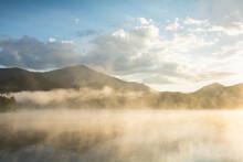USA, New York, North Elba, Lake Placid, Morning Mist Rising On Lake Placid