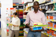 Lucky Afro American Man Holding Office Supplies At Stationery Store