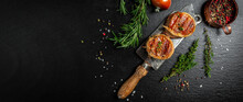 Premium Beef Steak. Portion Of Juicy Beef Tenderloin Steak Covered Bacon Served On Old Meat Butcher On Dark Concrete Background With Spices. Long Banner Format. Top View