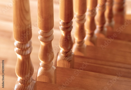 Cuadros en Lienzo Element of a wooden interior staircase. Wooden baluster close-up.