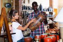 Woman Buys Traditional African Ceramics In A Store. High Quality Photo
