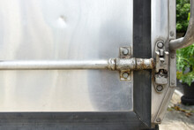 A Close Up Of Car Container Lockable System, Old And Rusty Container Lock System