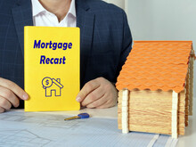 Financial Concept About Mortgage Recast With Phrase On Blank Book