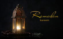 Muslim Lamp And Tasbih On Dark Background. Celebration Of Ramadan