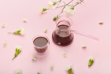 Tasty Coffee With Spring Flowers On Color Background