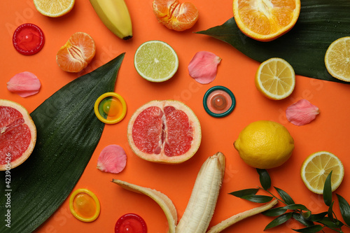 Obraz Sex concept with fruits and condoms on orange background - fototapety do salonu