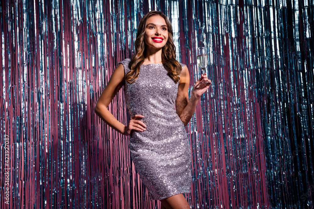 Fototapeta Portrait of attractive cheerful girl drinking wine retro fest 80s prom theme evening isolated on glossy tinsel colorful background - obraz na płótnie
