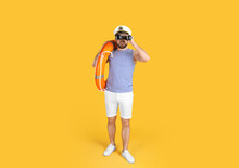 Sailor With Binoculars And Ring Buoy On Yellow Background