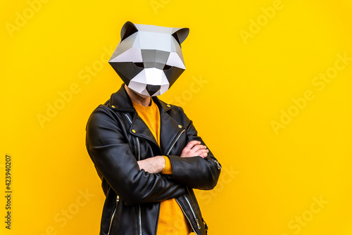 Fototapeta Man with funny low poly mask on colored background obraz